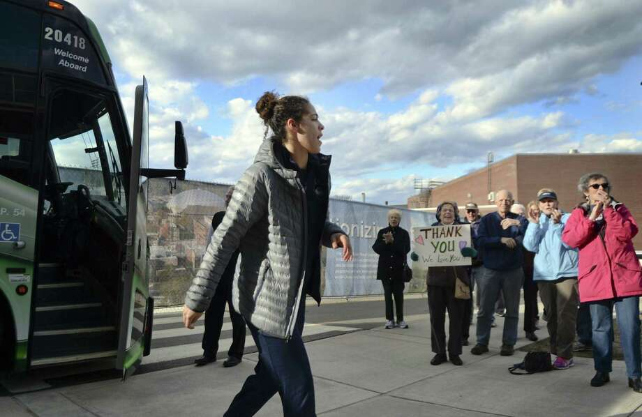 UConn's Kia Nurse acknowledges a small group of fans as she makes her way from the bus to the Werth Center on Sunday in Storrs. The Huskies returned home from Dallas after losing to Mississippi State on Friday night. Photo: Steven Dunn / Associated Press / Hartford Courant