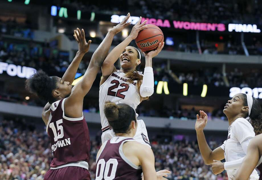 South Carolina's A'ja Wilson drives to the hoop against Mississippi State center Teaira McCowan (15). Photo: Tony Gutierrez, Associated Press