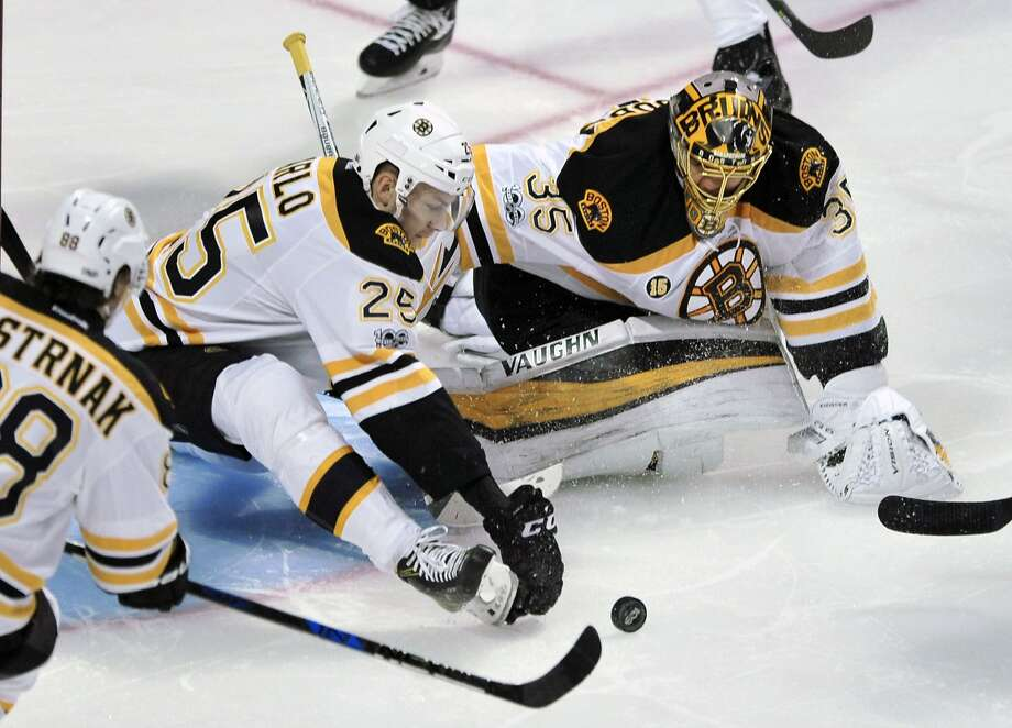 Boston's Brandon Carlo works in tandem with goalie Anton Khudobin to keep the puck out of the net in the Bruins' win. Photo: Paul Beaty, Associated Press