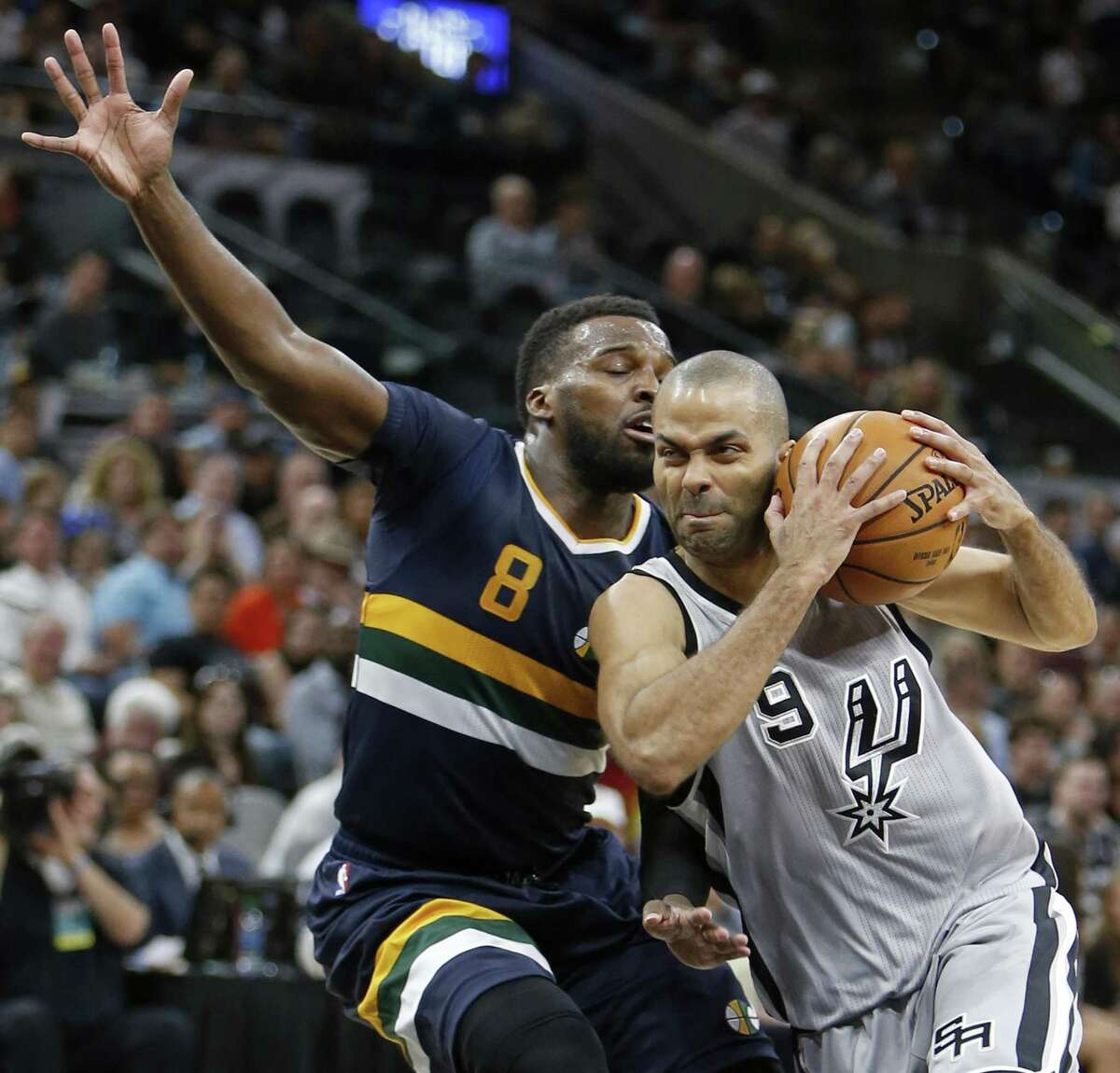Spurs' Tony Parker looks for room around the Utah Jazz's Shelvin Mack during their game April 2, 2017 at the AT&T Center.