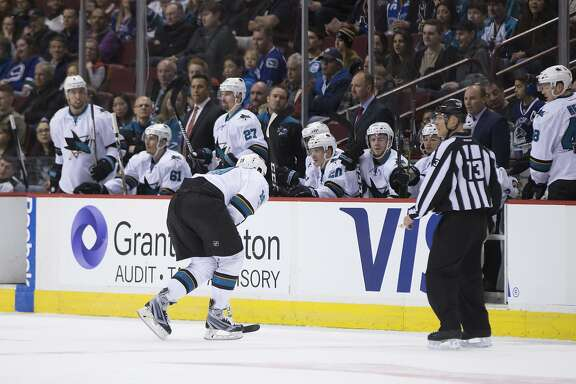 San Jose Sharks' Joe Thornton skates to the bench with an injury during the first period of the team's NHL hockey game against the Vancouver Canucks on Sunday, April 2, 2017, in Vancouver, British Columbia. (Darryl Dyck/The Canadian Press via AP)