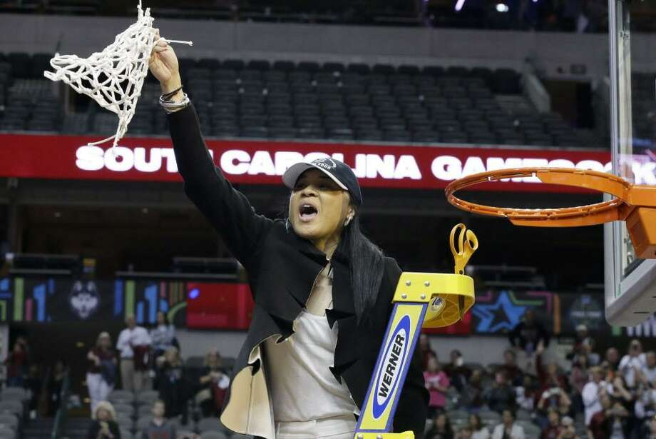 South Carolina coach Dawn Staley cuts down the net as she and the team celebrate their win over Mississippi State in the final of NCAA women's Final Four college basketball tournament, Sunday, April 2, 2017, in Dallas. South Carolina won 67-55. (AP Photo/LM Otero) Photo: LM Otero / Associated Press / Copyright 2017 The Associated Press. All rights reserved.