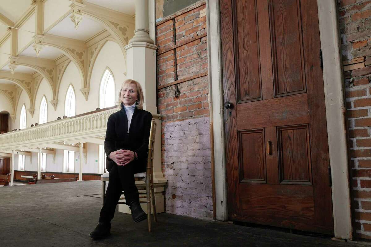 Teddy Foster, campaign director for Universal Preservation Hall, sits in the apse in the great hall of the building on Thursday, March 16, 2017, in Saratoga Springs, N.Y. (Paul Buckowski / Times Union)