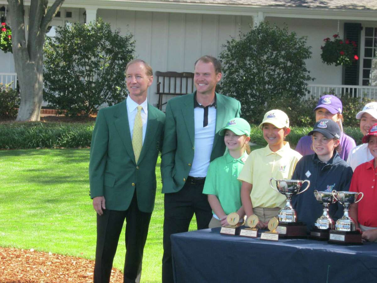 Participants in the girls' 10-11 age division of the national Drive, Chip and Putt Championship pose with an Augusta National member, far left, and 2016 Masters champion Danny Willett outside the Augusta National Golf Club clubhouse in Augusta, Ga. That's Kennedy Swedick, a 10-year-old from Voorheesville, in the green shirt with Willett. (Pete Dougherty / Times Union)