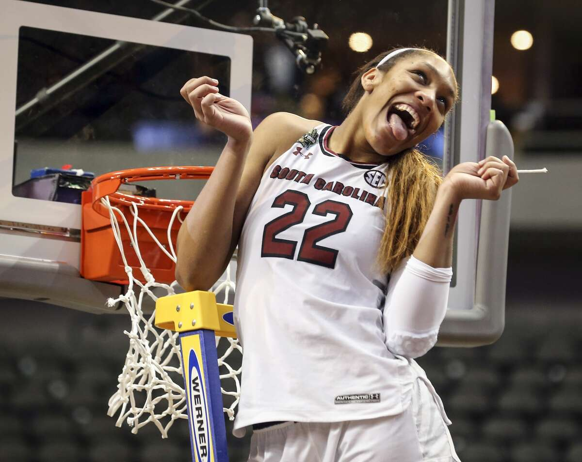 South Carolina forward A'ja Wilson (22) makes a face after cutting off a piece of the net following the team's 67-55 win over Mississippi State in the NCAA women's college basketball tournament Final Four championship game in Dallas, Sunday, April 2, 2017. (Richard W. Rodriguez/Star-Telegram via AP)