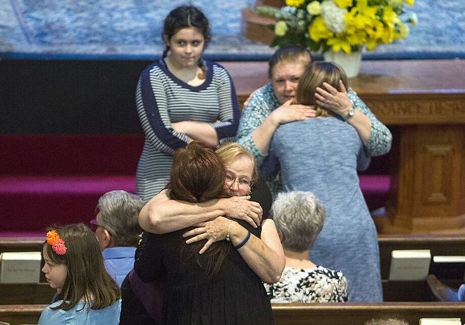 Congregants of First Baptist Church of New Braunfels comfort one another as they grieve the loss of 13 church members who were killed in a highway accident last week in Uvalde County after departing from a senior retreat in Leakey. Photo: Photos By Laura McKenzie / Herald-Zeitung