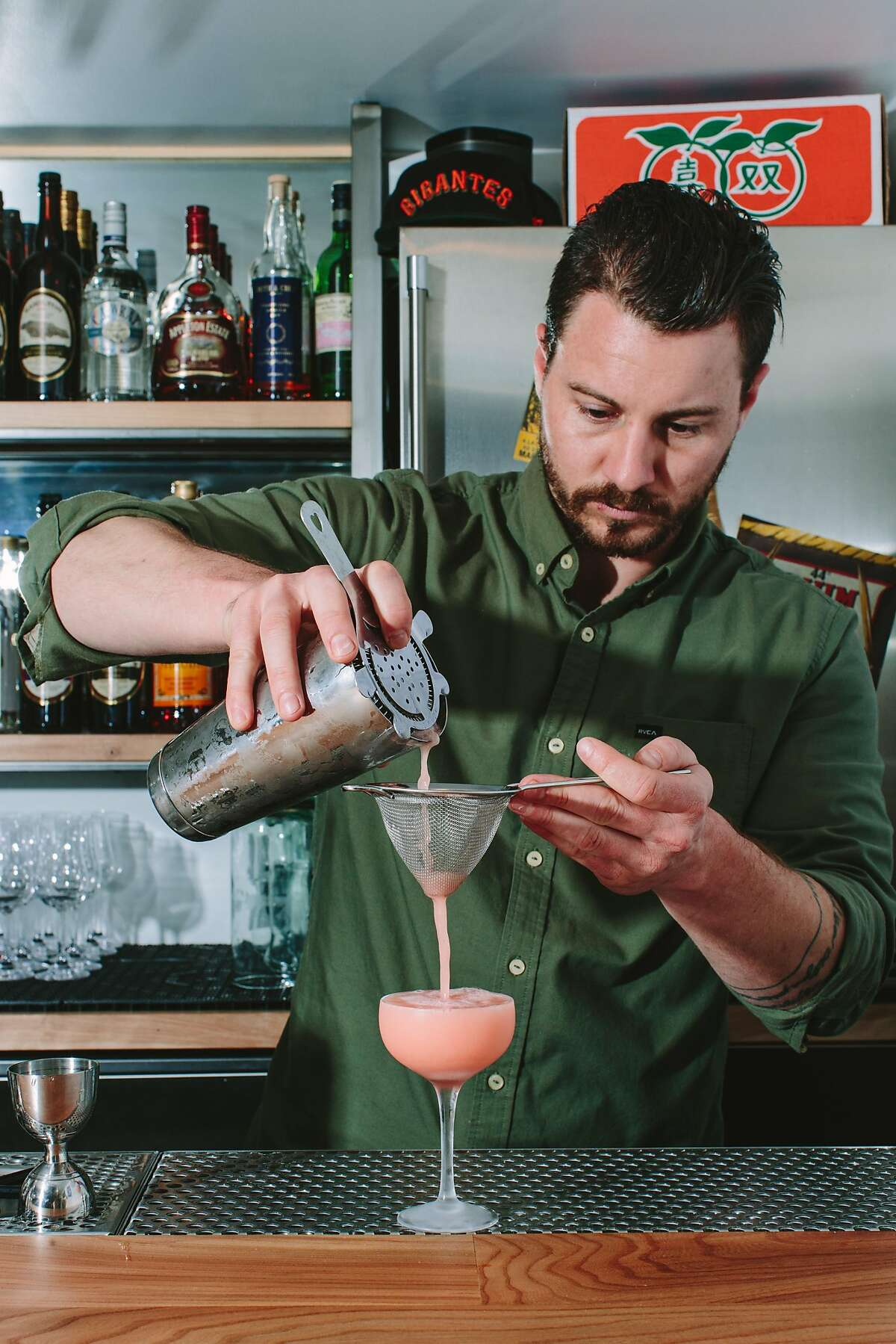 A bartender mixes The Pink Flamingo, one of the current rum drinks, at Over Proof, the reservations-only cocktail tasting menu experience in the upper level of ABV bar on March 30, 2017 in San Francisco. The rum theme will last another month and then the bar will be reset for a whiskey theme.