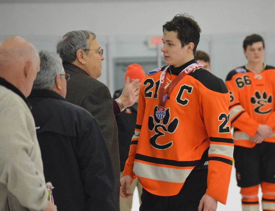Edwardsville senior Carson Lewis receives his bronze medal after Sunday night's game.