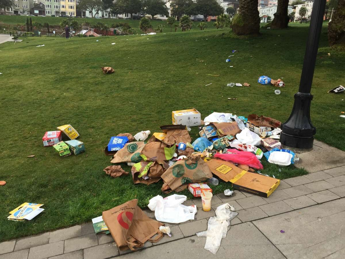 Dolores Park was littered with trash on the morning of Sunday, April 2, 2017, after gorgeous weather the day before attracted crowds.