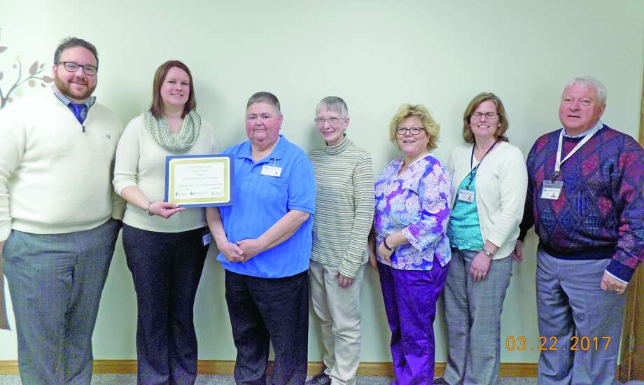 Shown are Jason Vice, regional director presenter of award, Senior Life Solution staff: Tennille Gibson, program director, Mary Jean Michalski, patient coordinator, Kimberly Arndt, clinical therapist, Kathy Booms, LPN nurse, Jill Wehner, hospital V.P./COO and Paul Clabuesch, hospital CEO/President. (Submitted photo)