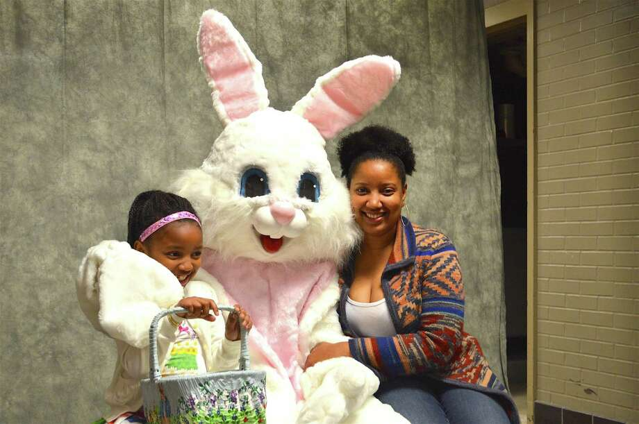 Shandia Mitchell of New Canaan and her daughter, Amira-Marie, 7, pose with the Easter Bunny at the Young Women's League's 45th annual Easter Egg Hunt at the New Canaan High School, Saturday, Apr. 1, 2017, in New Canaan, Conn. Photo: Jarret Liotta / For Hearst Connecticut Media / New Canaan News Freelance