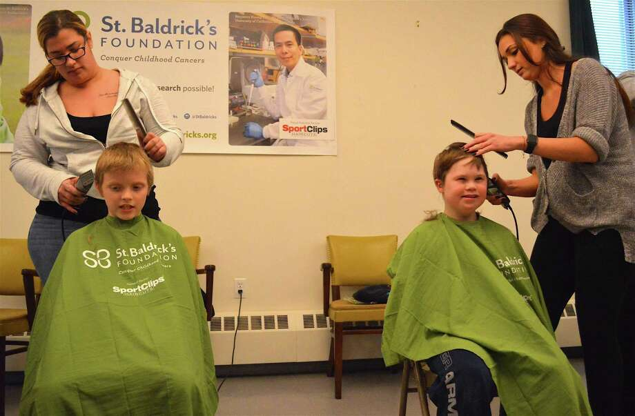 Andrew Blackwell, 9, left, and Brody Usher, 9, both of New Canaan, were among the first to be shaved at the Darien firefighter's annual St. Baldrick's Foundation head shaving for children's cancer research, at the Darien Fire Department,  Saturday, Apr. 1, 2017, in Darien, Conn. Photo: Jarret Liotta / For Hearst Connecticut Media / Darien News Freelance