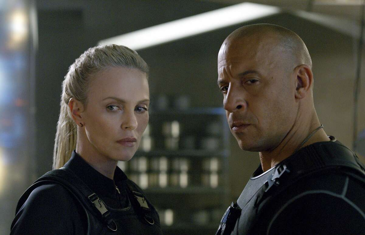 This image released by Universal Studios shows Charlize Theron, left, and Vin Diesel in a scene from