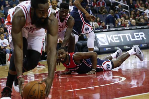 WASHINGTON, USA - NOVEMBER 7: Washington Wizard John Wall (2) watches as Houston Rocket James Harden (13) recovers a lost ball roll at the Verizon Center in Washington, USA on November 7, 2016. (Photo by Samuel Corum/Anadolu Agency/Getty Images)