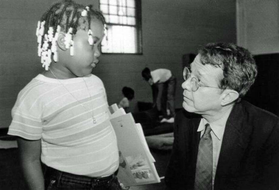"Author Jonathan Kozol speaking in 1993 to Pineapple, one of the children whose life he chronicles in his book ""Fire in the Ashes."" Photo: Contributed"