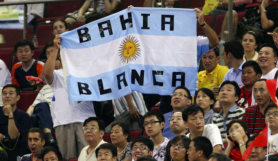 Argentine fans wave their country's flag, featuring Manu Ginobili's hometown of Bahia Blanca, during a 2008 Beijing Olympics tournament game against Lithuania. Photo: Edward A. Ornelas /San Antonio Express-News / EORNELAS@EXPRESS-NEWS.NET