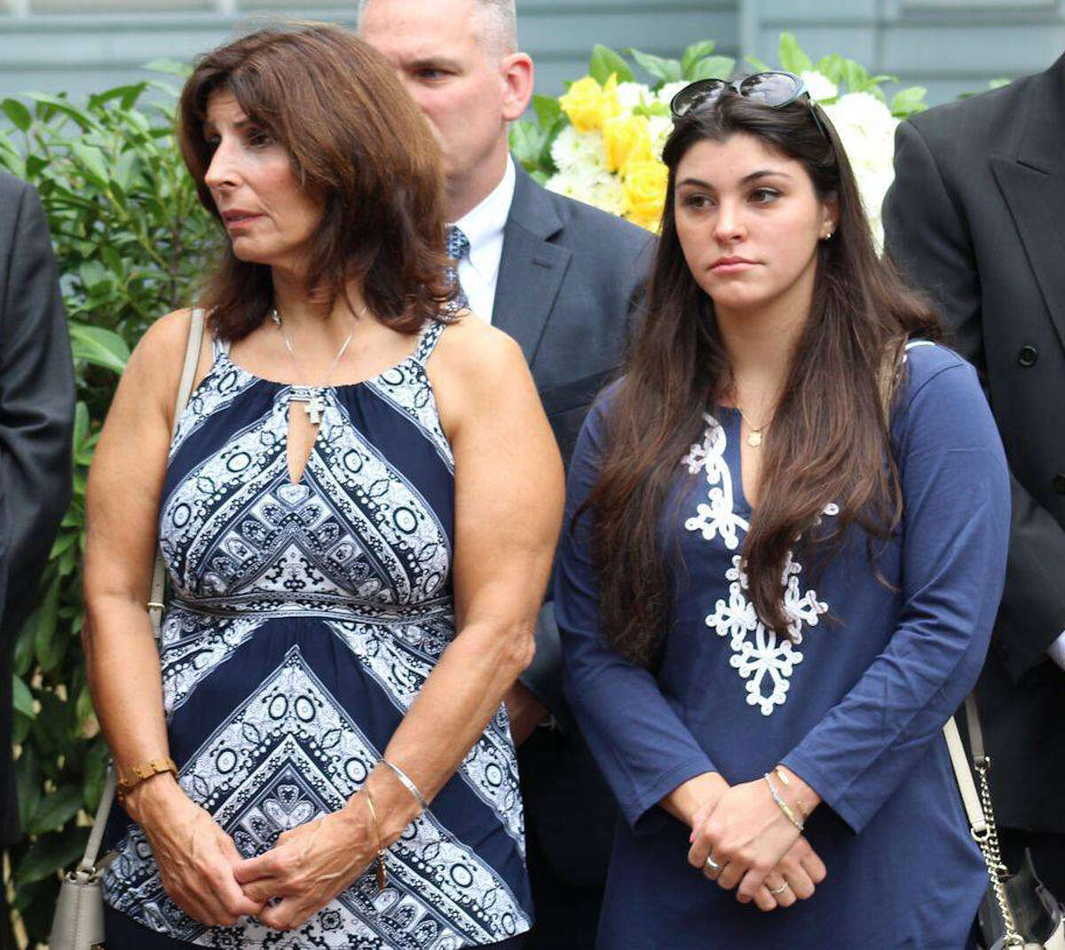 Roseanne Nelson and her daughter Caitlin Nelson at a 2016 9/11 ceremony held to honor her father, James A. Nelson, who was killed in the 2001 terrorist attack when Kaitlin was 5-years-old. Caitlin Nelson, 21, of Clark, NJ, died Sunday, April 2, 2017 from complications following a campus event on Thursday.