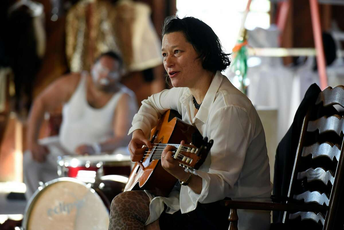 """Erika Chong Shuch plays the guitar during her all-day piece """"For You"""" performed in Marin, CA, on Saturday April 1, 2017."""