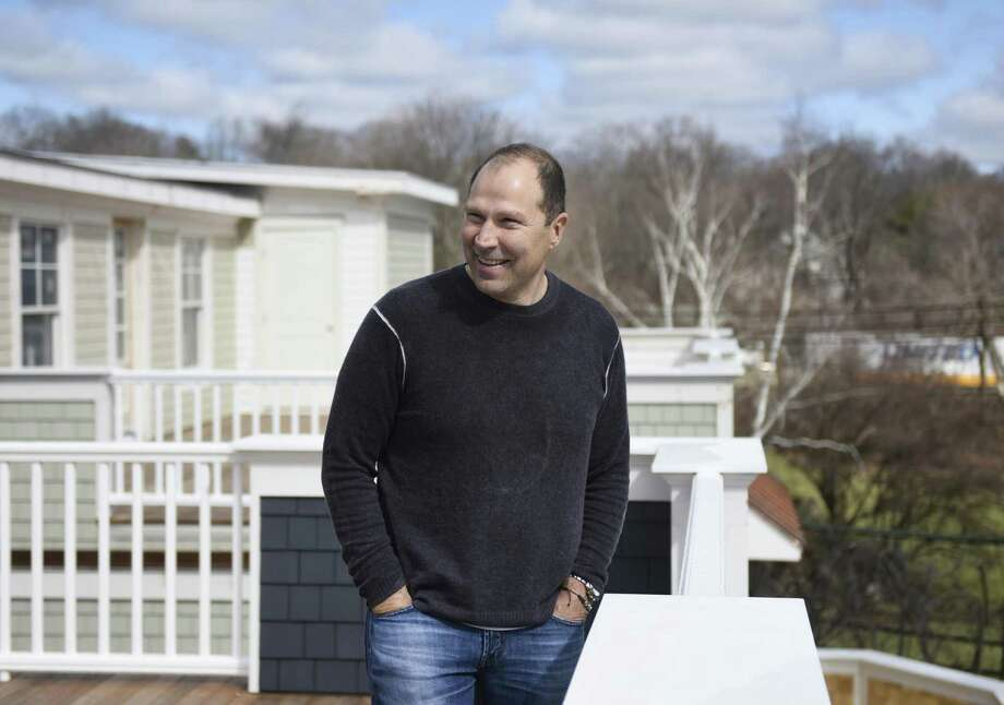 Left, Michael Caridi, of MAJIC Development Group, shows the view from a rooftop deck on one of the townhouses. Cadidi is the project's developer. Photo: Tyler Sizemore / Hearst Connecticut Media / Greenwich Time
