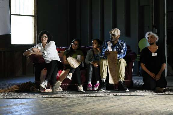 "From left, guests Blanca Cendejas, Erolina Kamburova, Aria Baldinger-Williams, Renard Williams, and Jullian Carter watch performers dance in the barn studio during Erika Chong Shuch�s all-day piece ""For You"" performed in Marin, CA, on Saturday April 1, 2017."