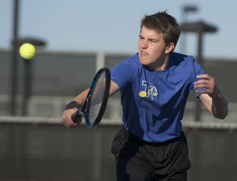 Justin Hofman, with Trinity School, returns a shot 03-24-17 during doubles play with Dylan Hofman at the TAPPS 1-4A semifinals at Bush Tennis Center. Tim Fischer/Reporter-Telegram Photo: Tim Fischer/Midland Reporter-Telegram