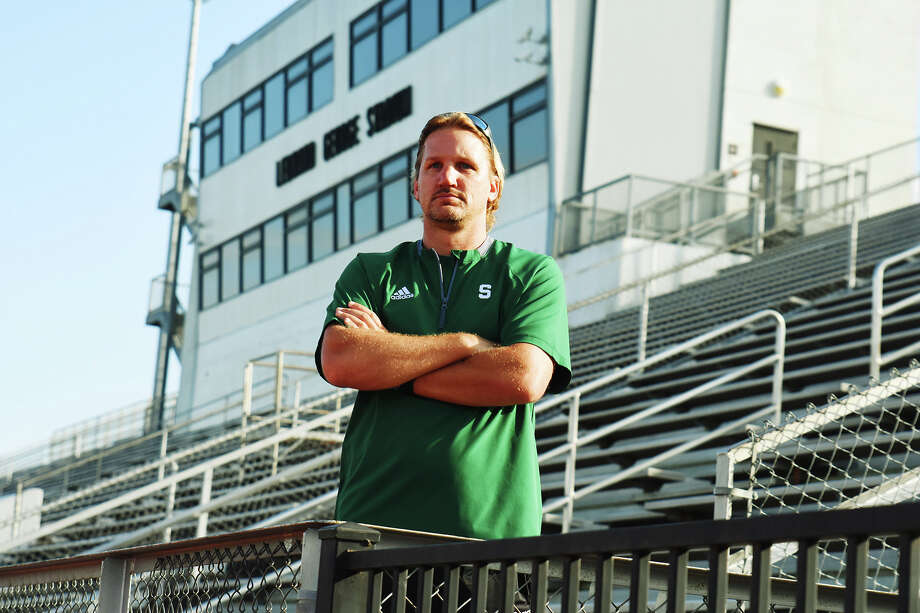 Spring High School assistant head coach and recruiting coordinator Chad Johnson stands amidst the bleachers at Leonard George Stadium. As recruiting coordinator, Johnson has facilitated dozens of student-athletes playing at the collegiate level, including Lonzell Gilmore (Texas Tech), Bravvion Roy (Baylor) and countless others. Photo: Tony Gaines / HCN