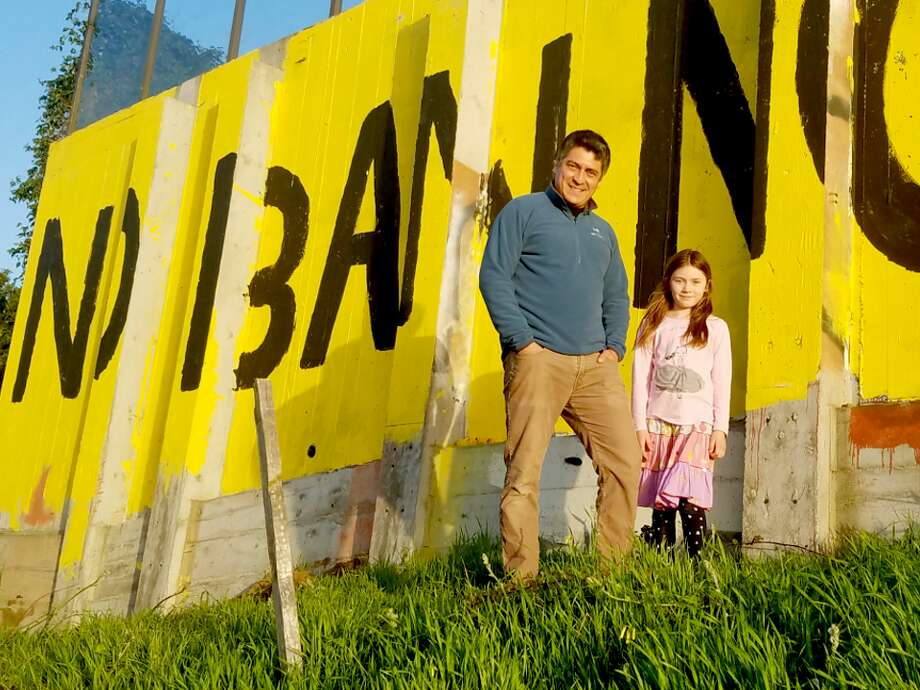 Ruben Flores and his daughter, Maya, in front of the sign. Photo: Hoodline,  With Permission To The Chronicle