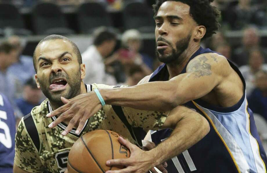 Tony Parker fights  Mike Conley to get to the lane as the Spurs host the Grizzlies at the AT&T Center on March 23, 2017. Photo: Tom Reel, Staff / San Antonio Express-News / Stratford Booster Club
