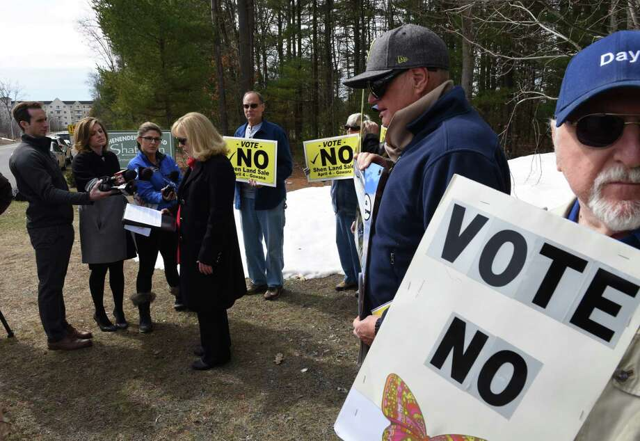 Susan Burton, vice president of the Friends of Clifton Park Open Space, left, speaks during a press conference where she disputed a flyer that is being circulated on Monday, April 3, 2017, in Clifton Park, N.Y. The flyer is telling people to vote yes when in fact Burton's group wants voters to vote no on the Shenendehowa school district land deal. On Tuesday, Shenendehowa school district residents will vote on whether to sell a 34-acres of pristine wooded land to a developer for a ShopRite or deny the sale with hopes of creating a Central Park for Clifton Park. (Will Waldron/Times Union) Photo: Will Waldron / 20040126A