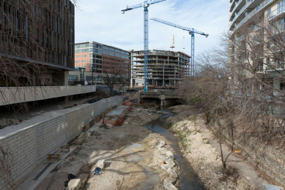 The Shoal Creek Walk is under construction, with views of downtown looking north from a pedestrian bridge. The Whole Foods headquarters can be seen immediately on the left. Photo: Leonid Furmansky