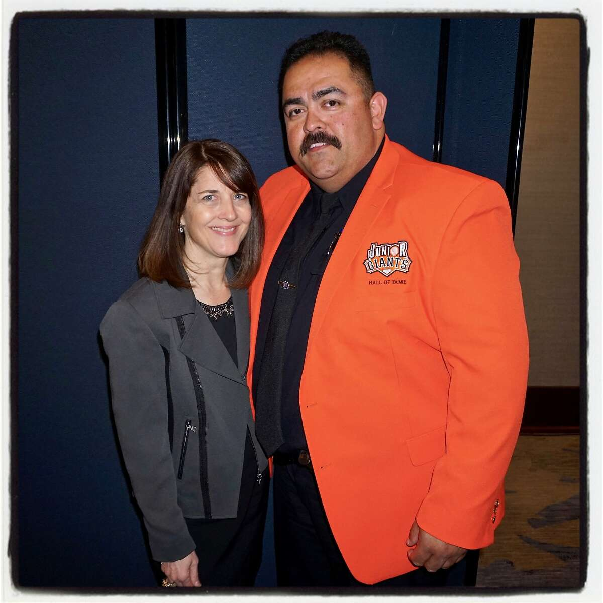 SF Giants Community Fund executive director Sue Petersen and Junior Giants Commissioner Angel Gonzalez at the Play Ball Lunch. March 31, 2017.