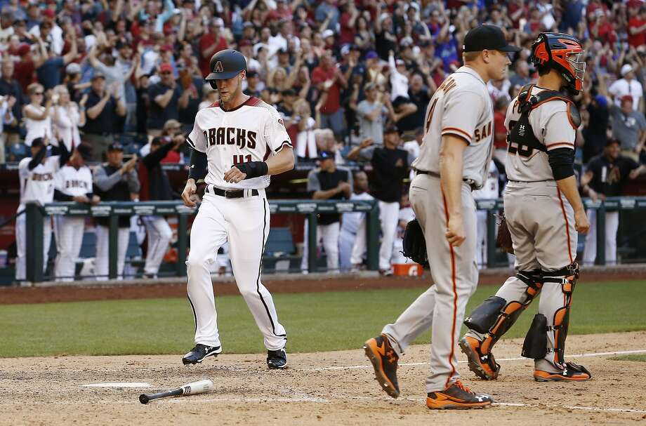 Buster Posey and Mark Melancon walk toward the mound after pinch-runner Jeremy Hazelbaker scores the tying run in the ninth inning Sunday. Photo: Ross D. Franklin, Associated Press