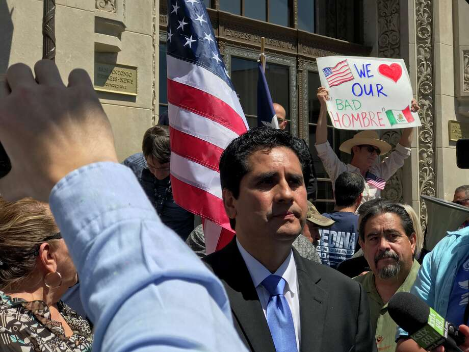 Mayoral candidate Manuel Medina and his supporters protest outside the offices of the San Antonio Express-News Monday, April 3, 2017, over a recent article by columnist Brian Chasnoff that questioned Medina's residence claims. Photo: Kelsey Bradshaw/San Antonio Express-News