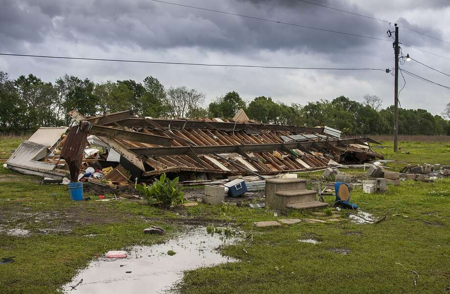 Debris from a pulverized mobile home covers a field in the small town of Breaux Bridge, La. A woman and her 3-year-old daughter were killed Sunday when a tornado destroyed the home. Photo: Lucius Fontenot, Associated Press