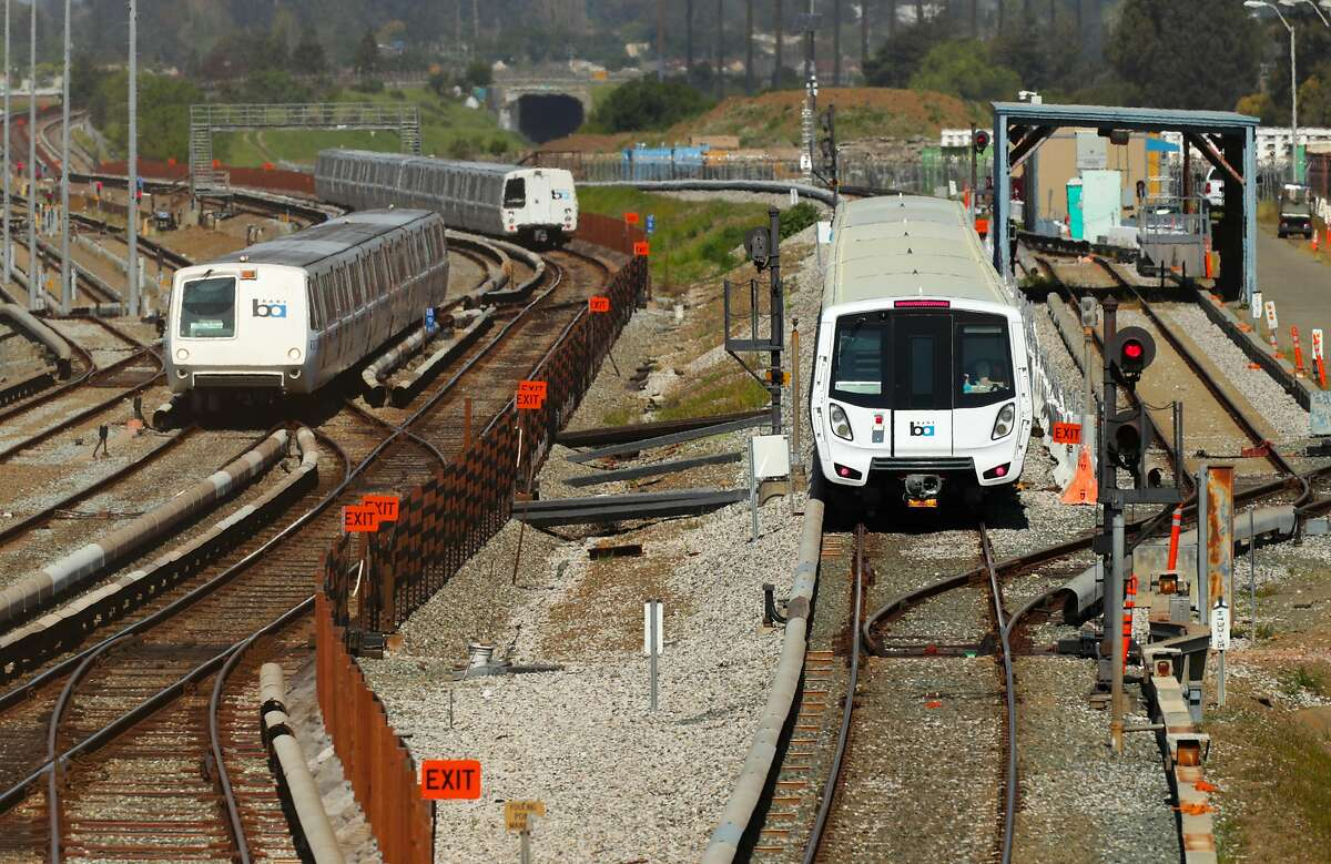 The new BART cars, (right) on the test track at the BART maintenance complex, as older trains pass, in Hayward, Ca. on Mon. April 3 2017.