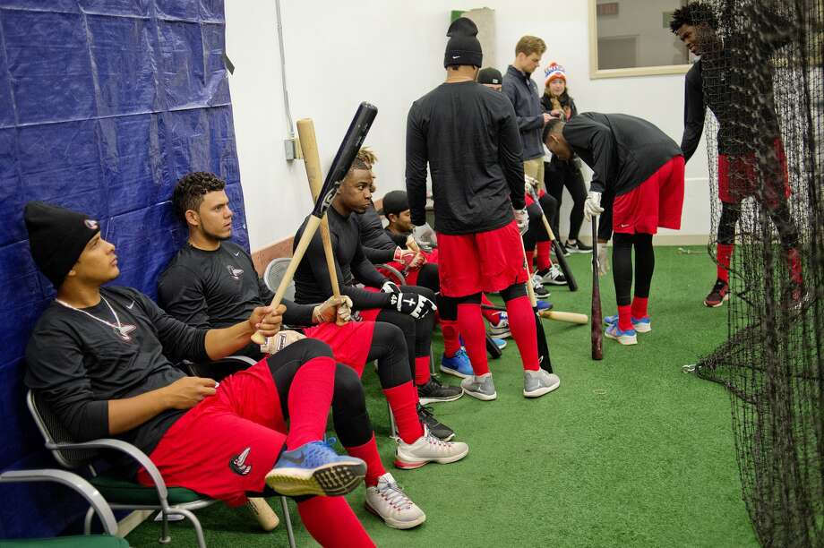 Great Lakes Loons' players wait for hitting practice at the batting cage on Monday at Dow Diamond. The Loons held their first practice in Midland inside due to the rainy weather. The Loons face the Lansing Lugnuts in their season opener scheduled for Thursday, April 6, in Midland. Photo: NICK KING | Nking@mdn.net
