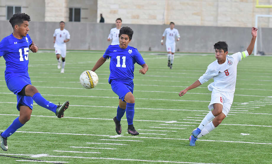 Junior Rogelio Lopez (8) and the Cypress Lakes Spartans defeated Cinco Ranch in the area playoffs to advance to the regional quarterfinals this week. Photo: Cy-Fair ISD