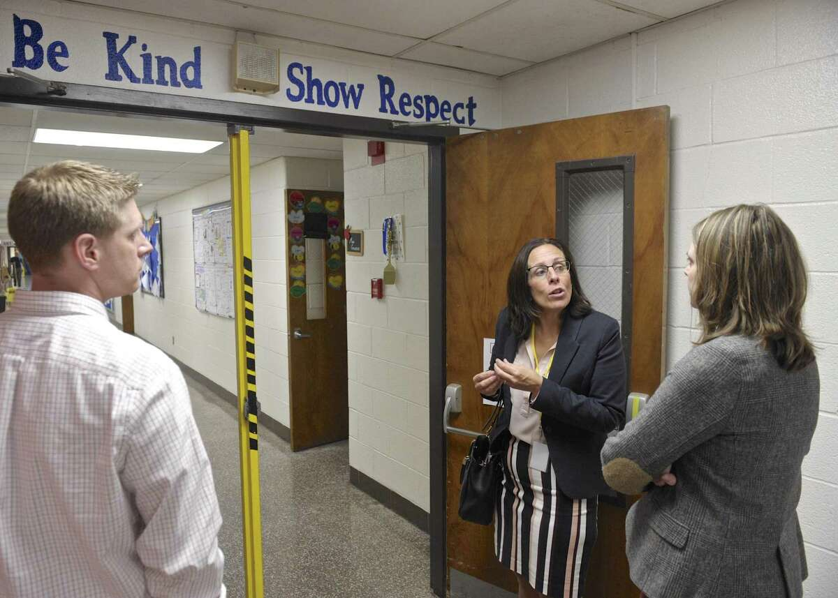 Kristan and Jim Sveda, of Bethel, listen to Bethel Superintendent of Schools Christine Carver during a tour of Rockwell School. Wednesday, October 5, 2016, in Bethel, Conn. The Sveda's have a son in second grade in the school.