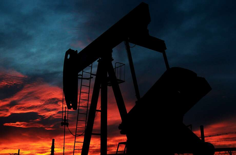 A pumpjack rocks back and forth as the sun sets Wednesday April 2, 2014 in Stanton, Texas. The Permian Basin in West Texas is on track to produce more oil within five years than any OPEC nation except Saudi Arabia, positioning the Texas Gulf Coast to rival the Persian Gulf when it comes to oil and gas activity. Photo: JOHN DAVENPORT /SAN ANTONIO EXPRESS-NEWS / ©San Antonio Express-News