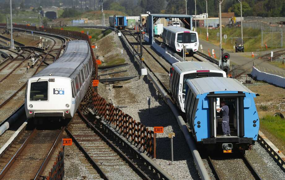 Workers begin testing of the new BART cars, (right) along the test track at the BART maintenance complex, in Hayward, Ca. on Mon. April 3 2017. Photo: Michael Macor, The Chronicle
