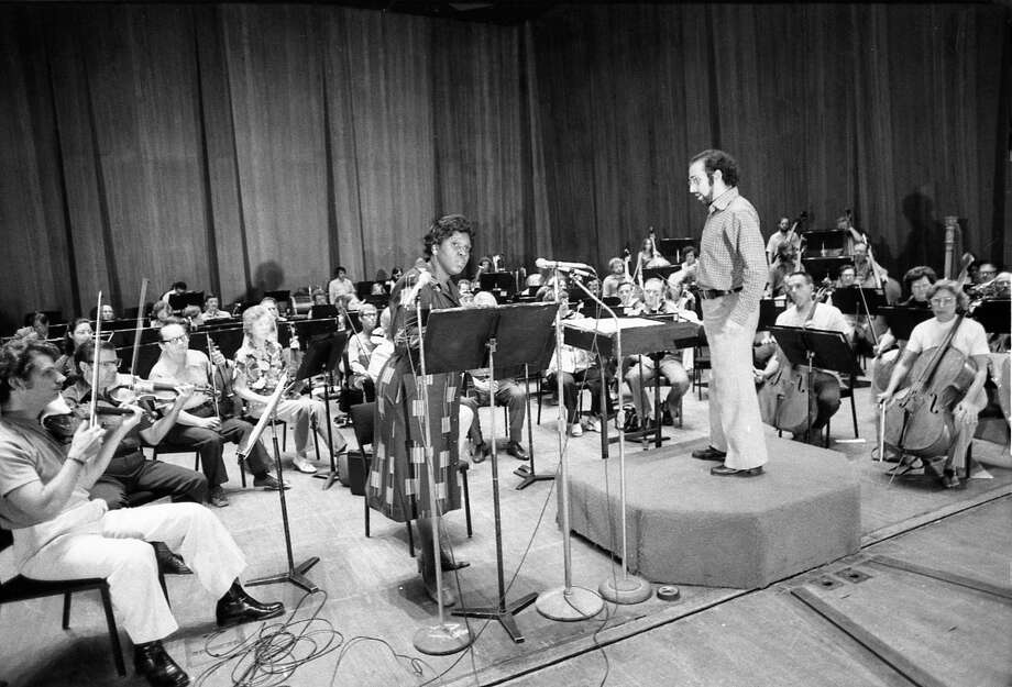 """09/08/1975 - Congresswoman Barbara Jordan narrates Aaron Copland's """"A Lincoln Portrait"""" with Houston Symphony conductor Lawrence Foster and the orchestra during afternoon rehearsal at Jones Hall. The opening night performance later in the evening will open the 62nd season of the Houston Symphony. Photo: Orie Collins, HC Staff / Houston Chronicle"""