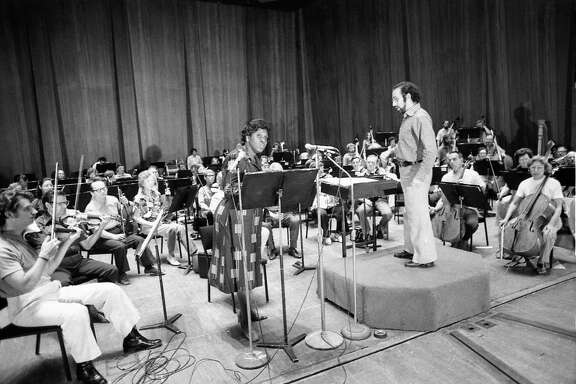 """09/08/1975 - Congresswoman Barbara Jordan narrates Aaron Copland's """"A Lincoln Portrait"""" with Houston Symphony conductor Lawrence Foster and the orchestra during afternoon rehearsal at Jones Hall. The opening night performance later in the evening will open the 62nd season of the Houston Symphony."""
