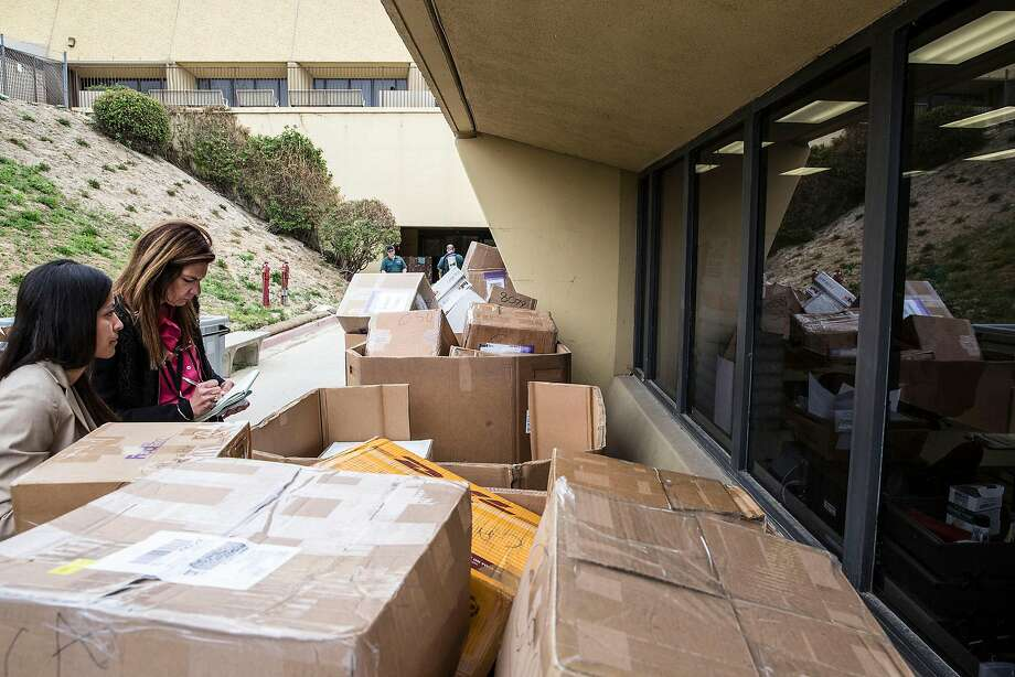 Stacked shipments of H-1B visa petitions outside a government processing center in Laguna Niguel, Calif., April 3, 2017. Possible changes to the program that allows technology companies to import foreign workers may be adding to an even heavier rush than usual this year. (Eros Hoagland/The New York Times) Photo: Eros Hoagland / New York Times 2017