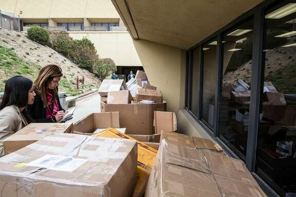 Stacked shipments of H-1B visa petitions outside a government processing center in Laguna Niguel, Calif., April 3, 2017. Possible changes to the program that allows technology companies to import foreign workers may be adding to an even heavier rush than usual this year. (Eros Hoagland/The New York Times)