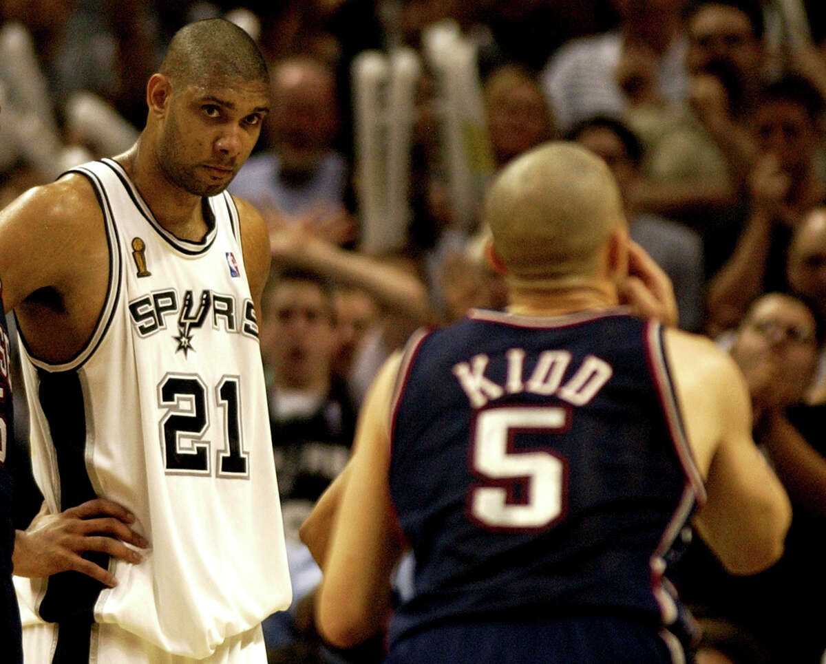 San Antonio Spurs forward Tim Duncan, left, watches as New Jersey Nets guard Jason Kidd, right, prepares to shoot a foul shot in the fourth quarter of Game 2 of the NBA Finals in San Antonio, Friday, June 6, 2003. (AP Photo/Eric Gay)