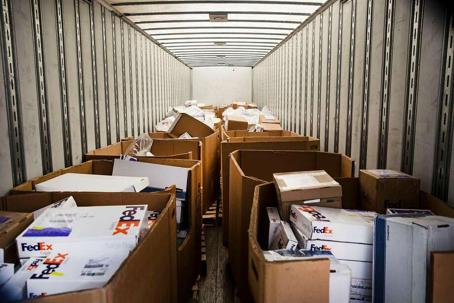 H-1B visa petitions wait in a truck for delivery to a processing center. Photo: EROS HOAGLAND, NYT