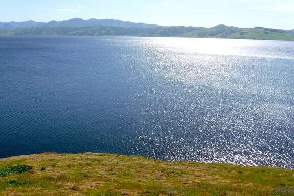 Giant San Luis Reservoir, located along Highway 152 between Gilroy and Santa Nella, started the winter only 13 percent full. It is now 100 percent full and ringed by green and spiked with blooming poppies and mustard.