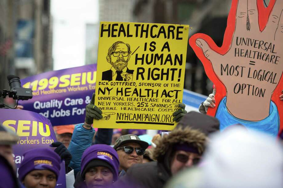 Health care activists promote the Affordable Care Act in front of Trump Tower in New York. Photo: Kevin Hagen, Stringer / 2017 Getty Images