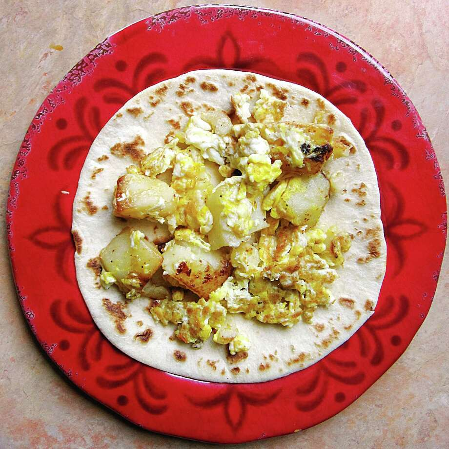 Potato and egg taco on a handmade flour tortilla from Fina's Kitchen on West Hildebrand Avenue. Photo: Mike Sutter /San Antonio Express-News