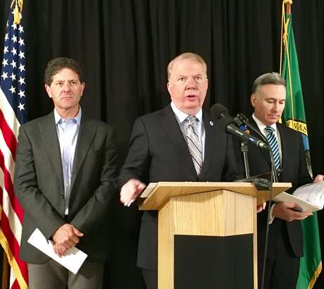 Seattle Mayor Ed Murray announced Monday that he is tossing his proposal to put a property tax levy on the August ballot to pay for homelessness programs and instead has teamed up with King County to propose a countywide sales tax hike in its place. Pictured: From left to right, Nick Hanauer, Seattle investor, Mayor Ed Murray, and King County Executive Dow Constantine prepare for a news conference on the sales tax proposal Monday, April 3, 2017. Photo: DANIEL DEMAY / SEATTLEPI.COM